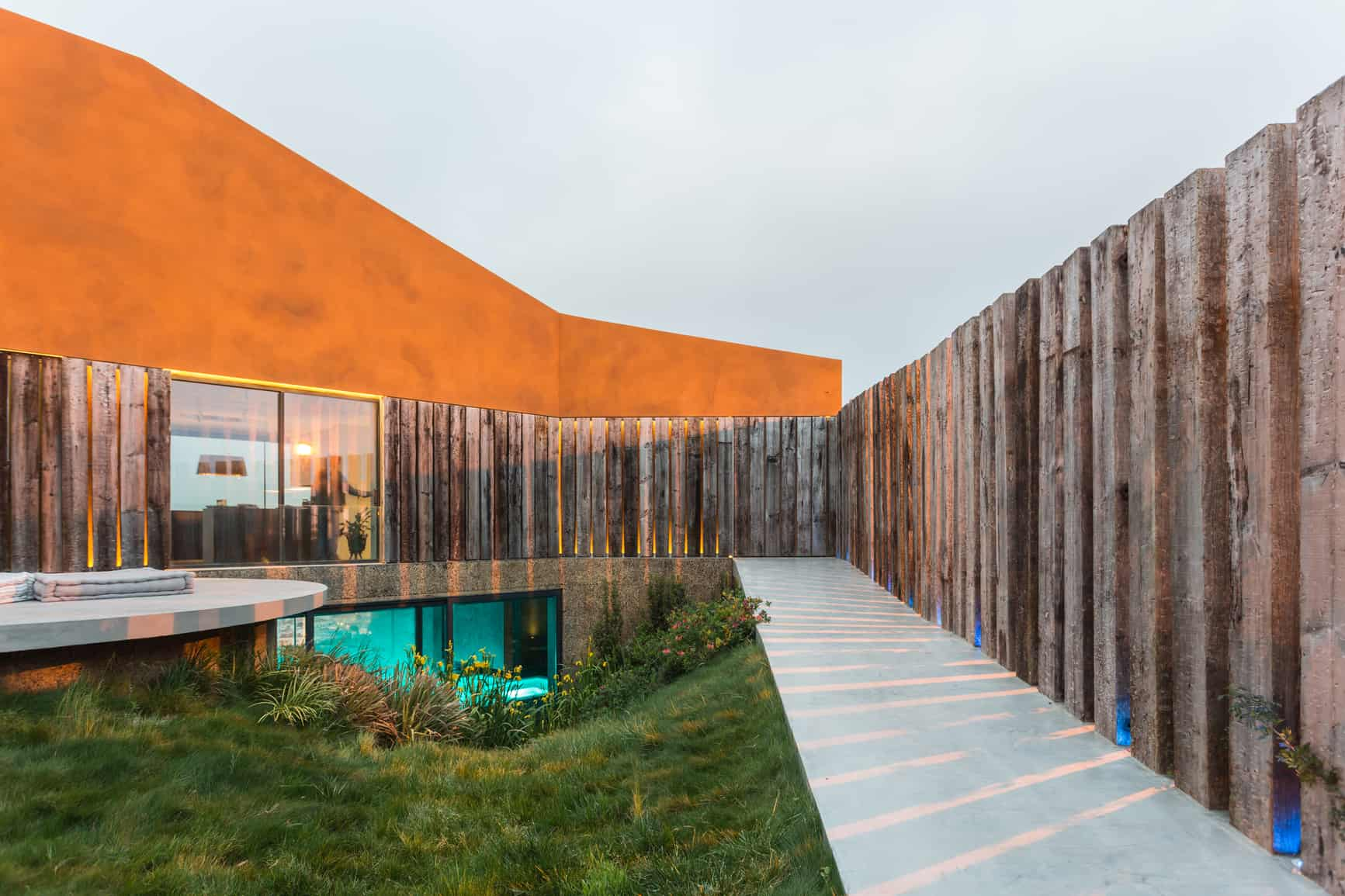 Modern architecture. Orange building. Wooden cladding. Grassy courtyard. R&D Tax credits. The challenge for architects.