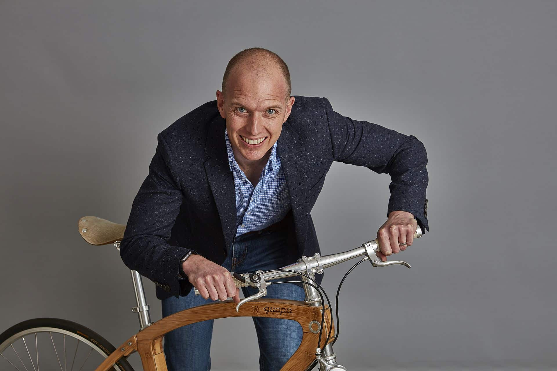 Simon Brown, IoD Young Director of the Year posing with bike